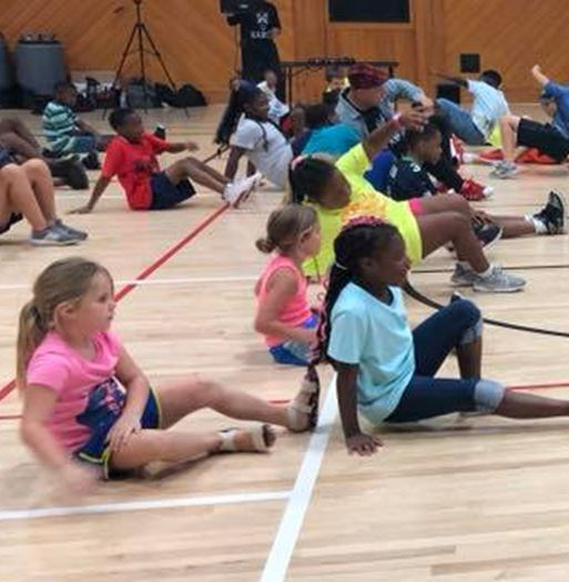 Group of kids in a gym for an activity